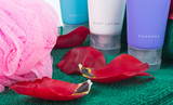 Toiletries with tulip petals poster