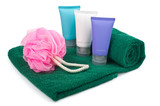 Toiletries on towel over white background poster