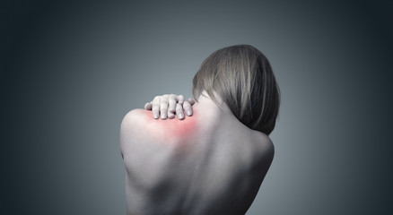 A woman suffering pain on her neck
