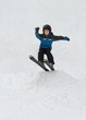 Little boy jumping on snow skis
