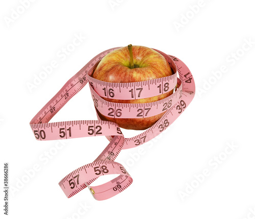 apple with measuring tape on a white background