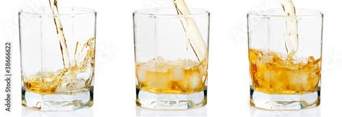 Cocktail pouring into glasses on a white background