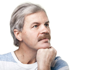 portrait of thoughtful mature caucasian man isolated on white