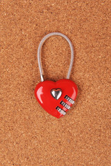 heart shape lock locked up with wood background .