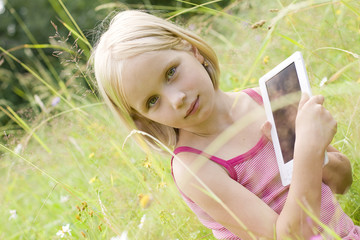 Teen girl reading electronic device - e-book