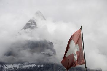 Swiss flag in front of Schwarzmonch rockface