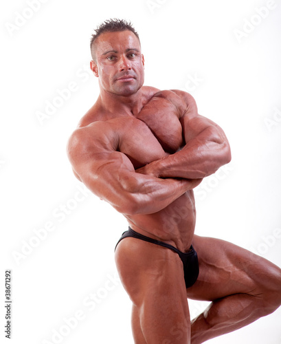 bodybuilder flexing his muscles isolated on white
