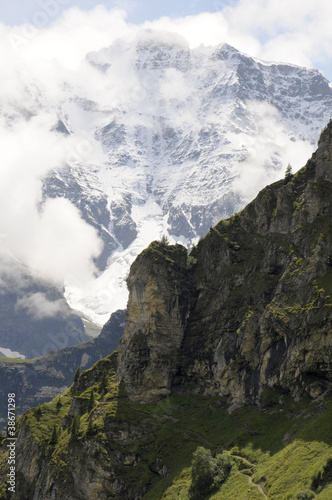 Wooded shoulder of rock in front of Breithorn mountain