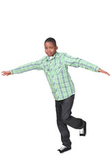 Cute african boy balancing on one leg