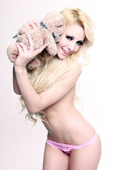 Sexy woman with teddy bear