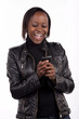 Gorgeous young South African woman reading a sms