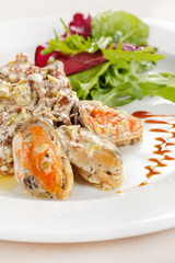 Fricassee with seafood and salad