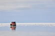 Red truck in Salar de Uyuni, salt flat in Bolivia
