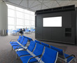 blank billboard and blue chair in international airport