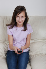Girl with TV remote control