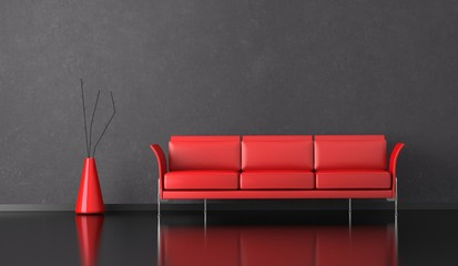Wohndesign - rotes Sofa vor grauer Wand