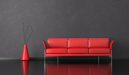 Wohndesign - rotes Sofa vor grauer Wand