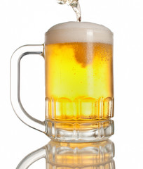 beer pouring on mug