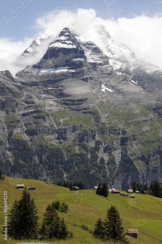 Schwarzmonch rockface of Jungfrau mountain above Swiss farm
