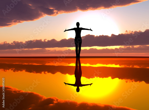 Woman welcoming the sunrise, praising the day