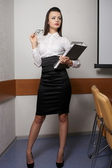 sexy business woman in an office with glasses red lips