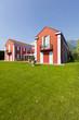 Big house in exterior with graden
