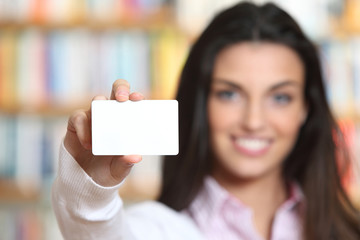 smiling young female showing a business card  -  copy space.
