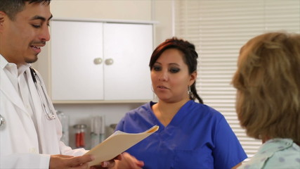 Latin American Doctor and Nurse Talk to Patient