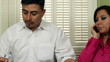 Hispanic Couple Unhappy Man Going Over Bills
