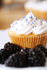 Cupcake with blackberries
