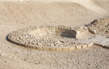 Foundation remains of the circular tower of Bahrain Fort