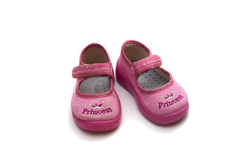 pink girl's shoes on white