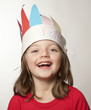little girl with Indian headband made of  paper - carnival mask