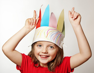 little girl with Indian headdress made of paper - carnival mask