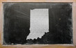 outline map of us state of indiana on blackboard