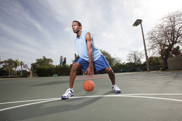 Basketball player dribbling the ball