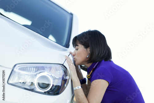 Woman kissing her new car