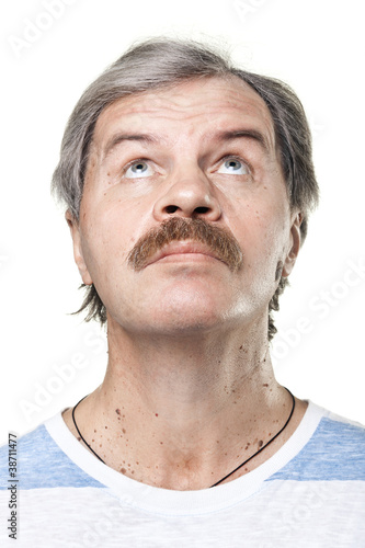 portrait of looking up mature man isolated on white background