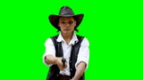 Cowboy on green background shoots from gun