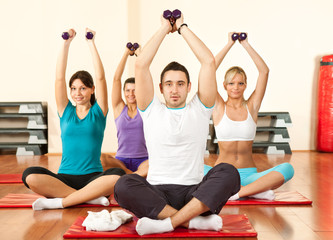 young people doing exercises with dumbbell