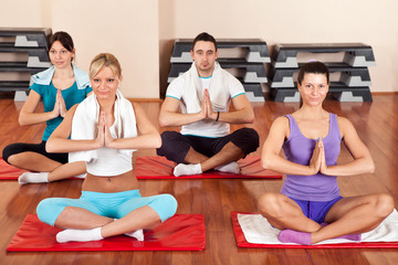 Group of people doing yoga exercises
