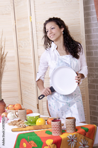 beautiful woman in kitchen making breakfast