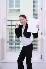 Success feeling, young woman with a blank certificate