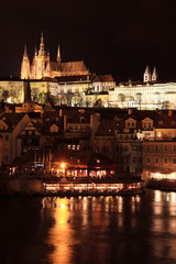 View on Prague gothic Castle with Charles Bridge in the Night