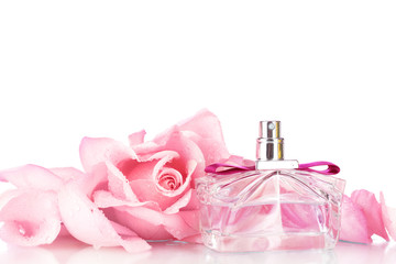 Perfume bottle and pink rose on pink
