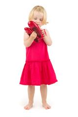 little girl in red shoes