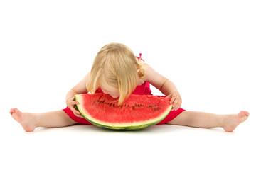 child eats melon