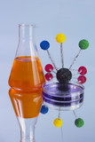 orange flask and petri dish