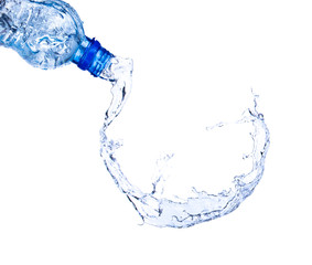 Fresh water splashing out of bottle on white background