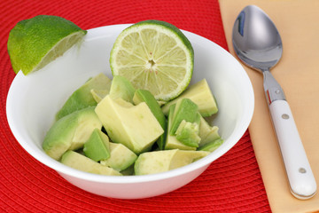 Avocado with Lime Wedges